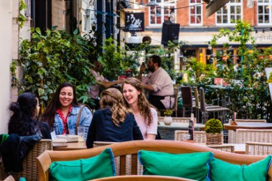 four women dining al fresco on Heddon Street
