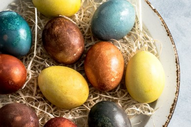 painted eggs on bed of straw